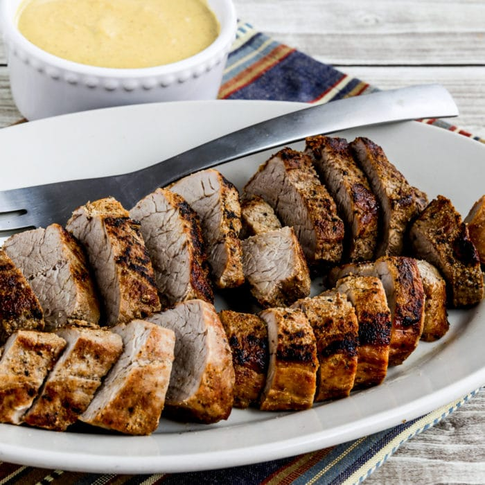 Pork Tenderloin with Mustard Sauce square image of finished pork on serving plate with sauce