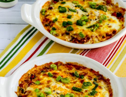 Mexican Baked Eggs finished in two baking dishes with Mexican salt pepper shakers