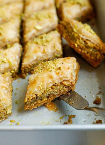 Close up of a pistachio baklava in a baking pan.