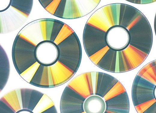 Easy Ways To Recycle Old CDs & DVDs (Because Trashing Them Is A No-No)