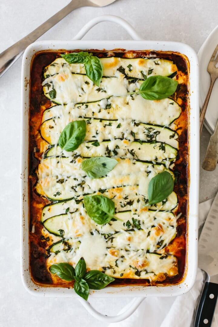 Zucchini lasagna in a white casserole dish.