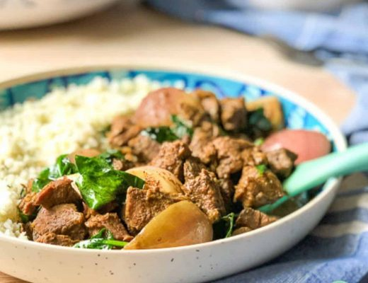 beef rendang served with cauliflower rice in a blue and white dish