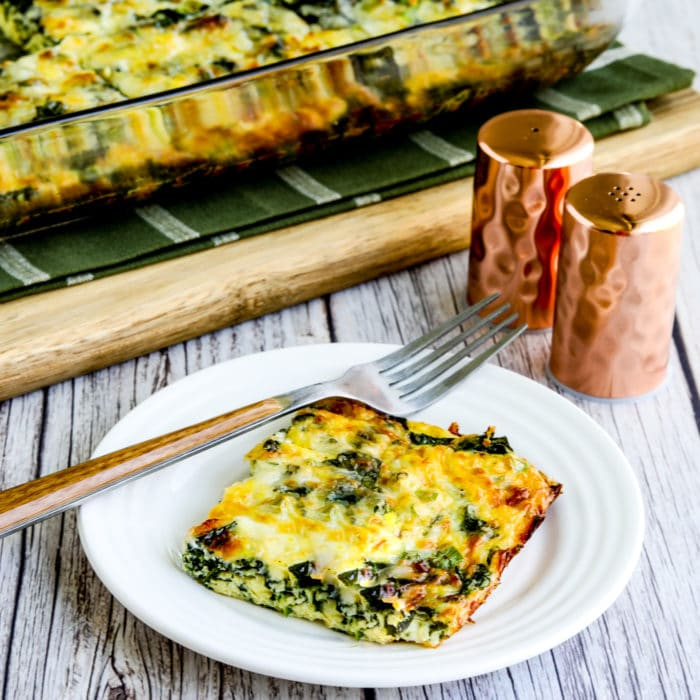 thumbnail image of Kale, Mozzarella, and Egg Bake, one slice on plate and casserole dish in background